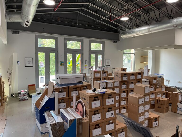 Office area filled with packed boxes.
