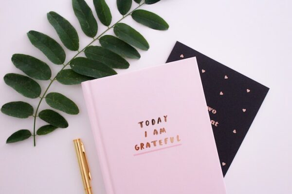 "Pink notebook titled ""Today I'm grateful for""."