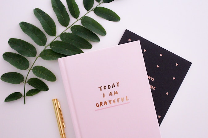 """Pink notebook titled """"Today I'm grateful for""""."""