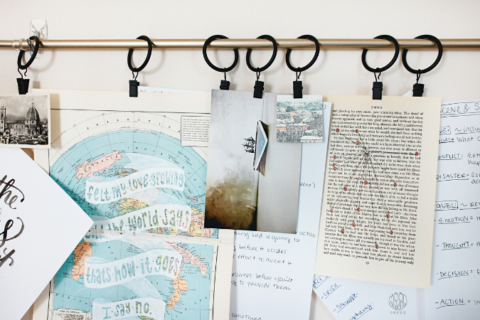 Vision board attached to a curtain rod.