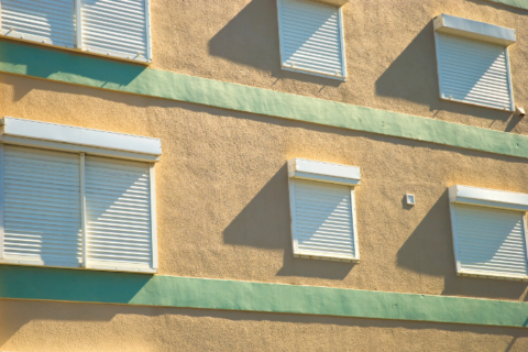 Closeup of building with hurricane shutters.