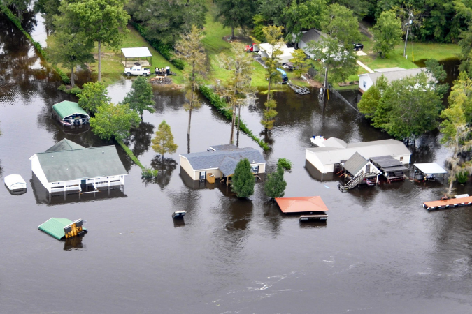 Aerial view of homes flooding.