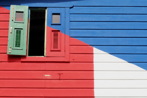 A house painted with the Puerto Rican flag on the outside.